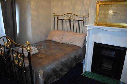 A bed or beds in a room at Blyth Hotel