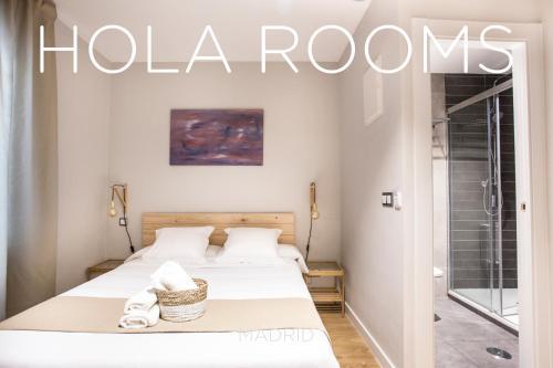 Cama o camas de una habitación en Hola Rooms