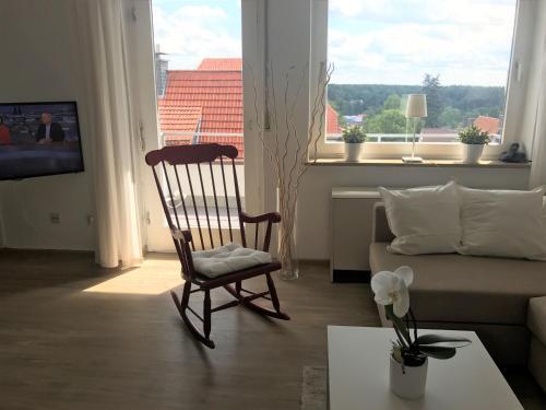 Ein Sitzbereich in der Unterkunft Ferienwohnung Clasen-Schulz/Hollmann