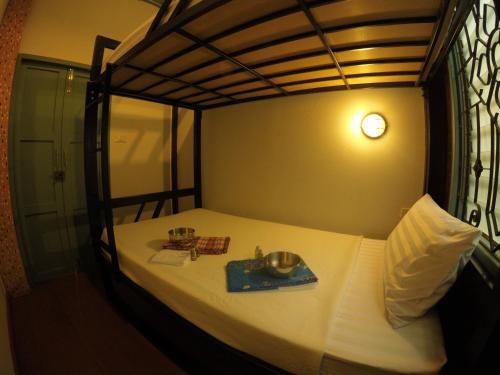 Ein Bett oder Betten in einem Zimmer der Unterkunft La Moon Hostel