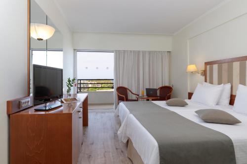 TV o dispositivi per l'intrattenimento presso Best Western Plus Hotel Plaza