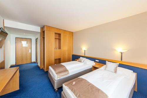 A bed or beds in a room at Novum Hotel Kavalier