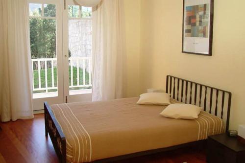 Uma cama ou camas num quarto em Quinta das Mineirinhas