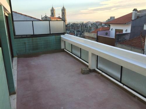 Uma varanda ou terraço em São Brás Apartment