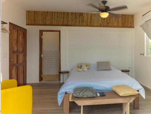 A bed or beds in a room at Aaki Hotel