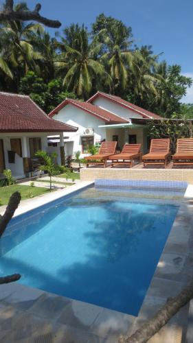 Der Swimmingpool an oder in der Nähe von Sammy Homestay