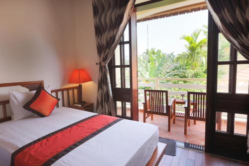 Ein Bett oder Betten in einem Zimmer der Unterkunft Windbell Villa Hoi An