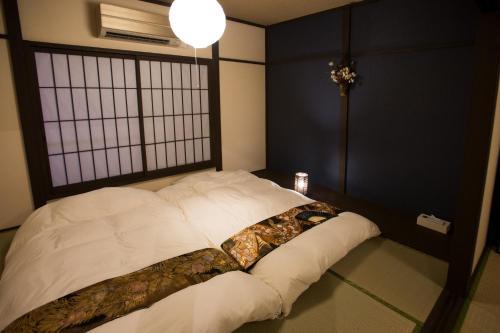京華宿 二条城別邸にあるベッド