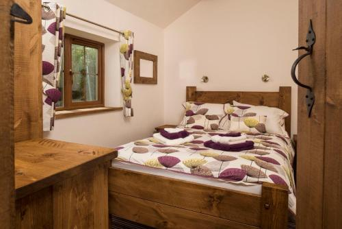 A bed or beds in a room at Barmston Farm