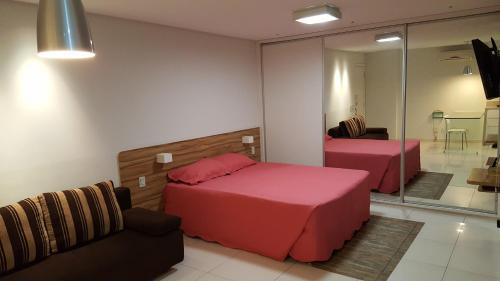 A bed or beds in a room at Apart-hotel