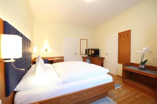 Ein Bett oder Betten in einem Zimmer der Unterkunft Hotel Ickhorn