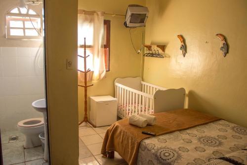 Cama ou camas em um quarto em Pousada Requinte de Trindade