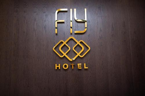 A certificate, award, sign, or other document on display at Fly Hotel