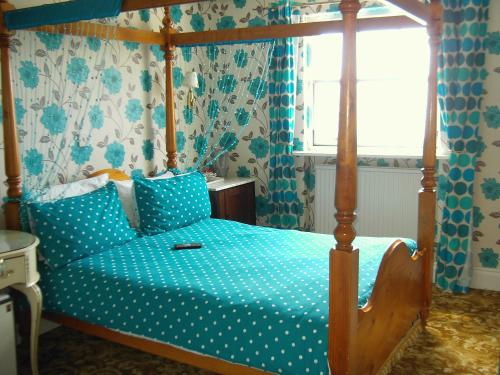 A bed or beds in a room at The Prince Regent