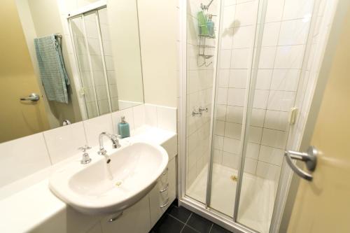 A bathroom at Flinders Lane Superior Studio Apartment