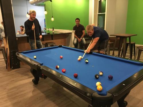 A pool table at Apple Hostels of Philadelphia