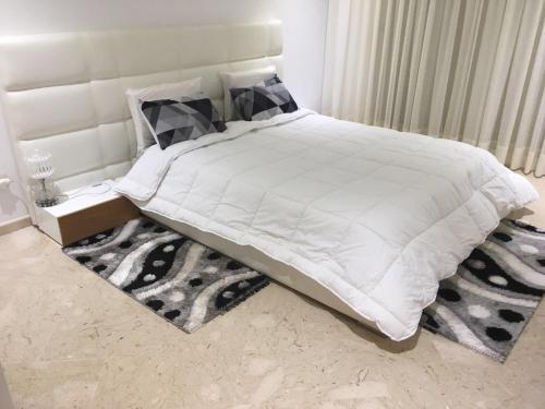 سرير أو أسرّة في غرفة في Peninsula