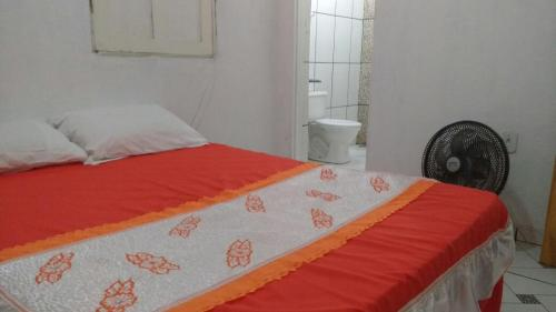A bed or beds in a room at Hostel Ilhéus