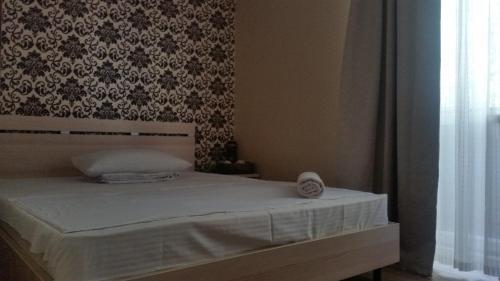 A bed or beds in a room at Apartments on Ahmetova 4