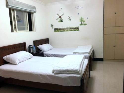 全壘打民宿 房間的床