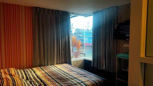 Un ou plusieurs lits dans un hébergement de l'établissement Tonnum Resort