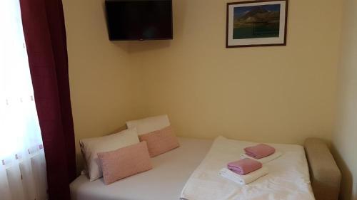 Кровать или кровати в номере Pension Kiwi