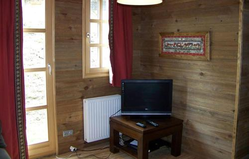 A television and/or entertainment center at Odalys Chalet Melusine