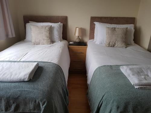 A bed or beds in a room at Kathleen House