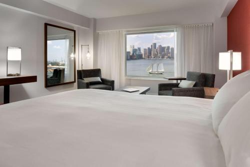 A bed or beds in a room at Hyatt Regency Boston Harbor