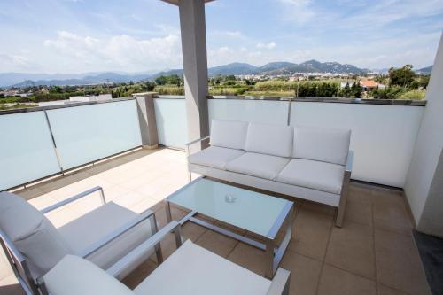 Un balcón o terraza de ApartHotel Playa Oliva