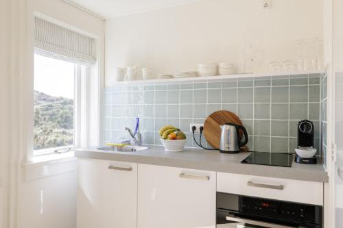 Een keuken of kitchenette bij Villa Parnassia