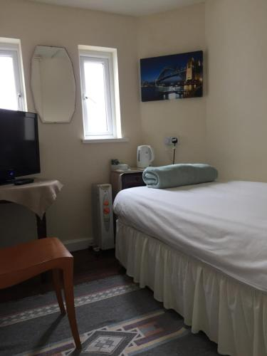 A bed or beds in a room at Cefn Mably Hotel