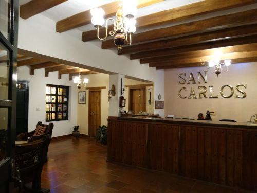 El vestíbulo o zona de recepción de Hotel Hospederia San Carlos Villa De Leyva