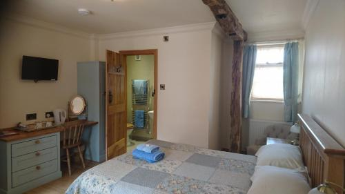 A bed or beds in a room at Church Farm Accomodation
