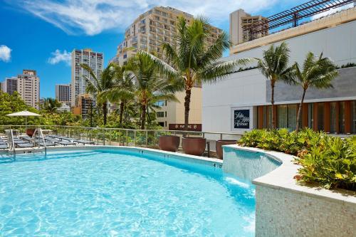 The swimming pool at or near Hilton Garden Inn Waikiki Beach