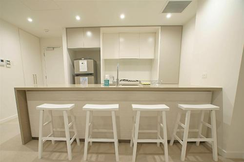 A kitchen or kitchenette at City Fringe Luxury Two Bedroom Apartment