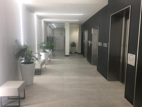 The lobby or reception area at Absolute Collins