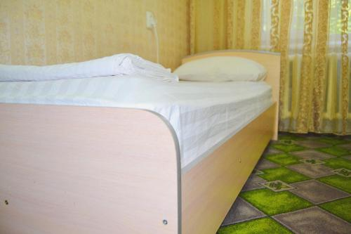A bed or beds in a room at Osh Guesthouse