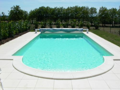 The swimming pool at or near La Tuilerie du Paligny