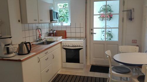 A kitchen or kitchenette at Royaltybed Copenhagen