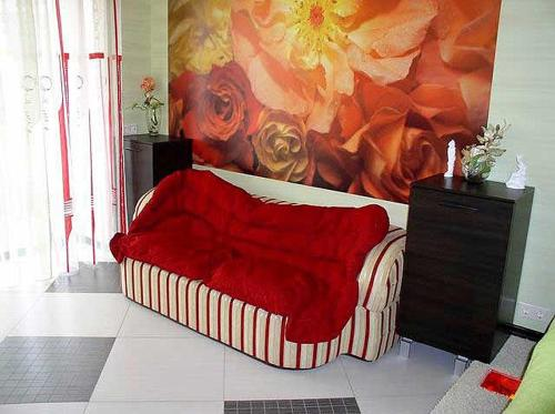 A bed or beds in a room at Dzhon Govard Studio