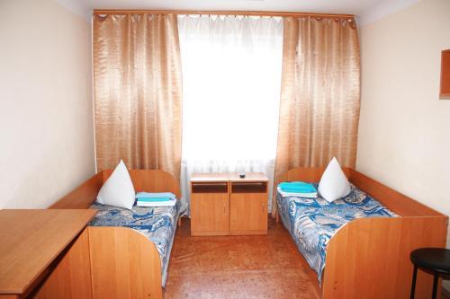 Кровать или кровати в номере Отель Выдубичи
