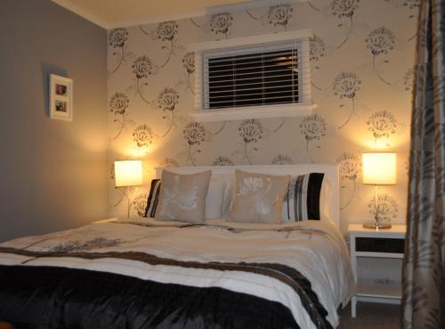 Säng eller sängar i ett rum på 16 Havelock