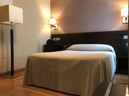 Cama o camas de una habitación en Hotel Baltico