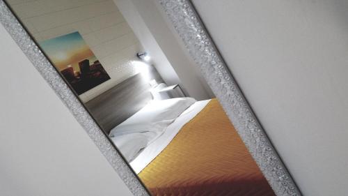 Letto o letti in una camera di La Bella Vita