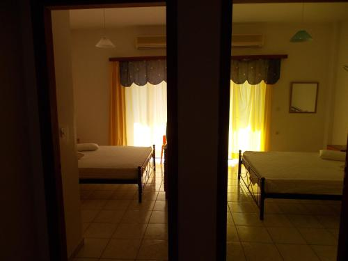 Krevet ili kreveti u jedinici u okviru objekta Helios&Thalassa Rooms