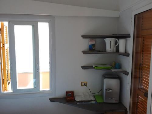 A kitchen or kitchenette at Affittacamere Elisabetta