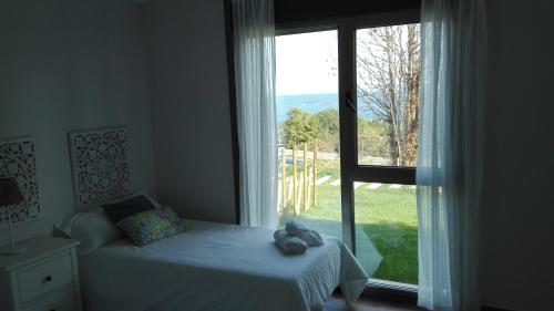 Cama o camas de una habitación en Casa Nueva Playa Areabrava Hio