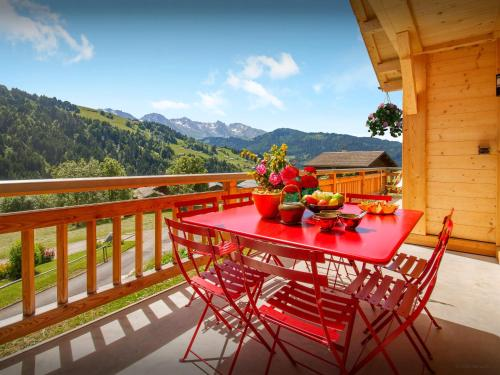 A balcony or terrace at Chalet Le Charmieux - OVO Network