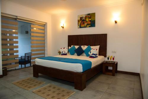 A bed or beds in a room at Anantamaa Hotel